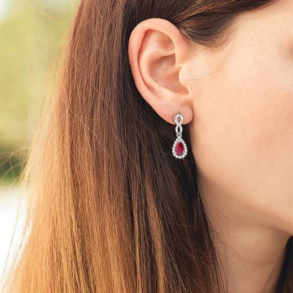 5x3 MM Pear Shape Ruby and 1/6 Ctw Round Cut Diamond Earrings in 10K White Gold Image 4 Becker's Jewelers Burlington, IA