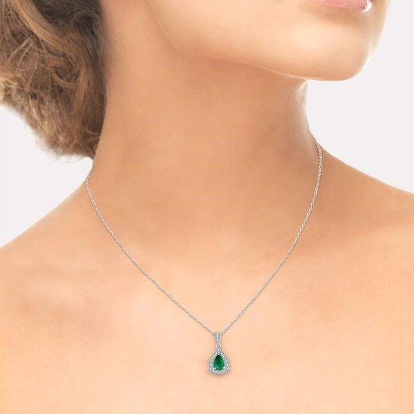 6x4 mm Pear Shape Emerald and 1/10 Ctw Round Cut Diamond Pendant in 14K White Gold with Chain Image 4 Becker's Jewelers Burlington, IA
