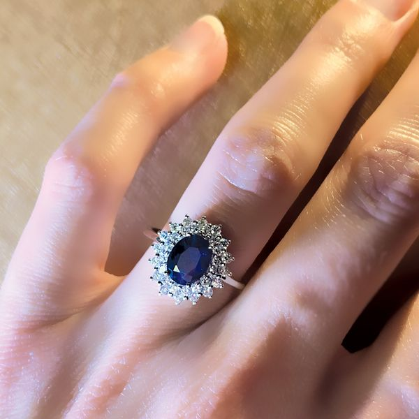 Oval Sapphire and Diamond Double Halo Ring in White Gold Image 4 Bremer Jewelry Peoria, IL