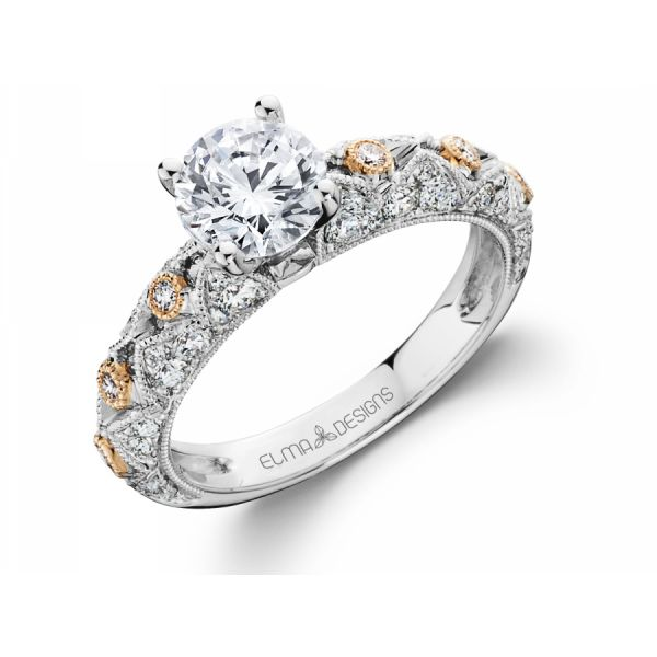 18k white & rose gold engagement ring set with 0.60 carats of diamonds (excluding center stone)