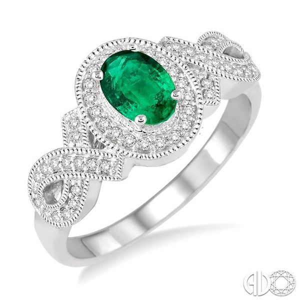 6x4 MM Oval Cut Emerald and 1/4 Ctw Round Cut Diamond Ring in 10K White Gold Coughlin Jewelers St. Clair, MI