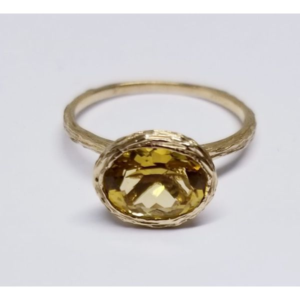 4 Karat Yellow Fashion Ring  with One Oval Citrine 7mm X 9mm. Textured Shank and Bezel. Size 7 Barnes Jewelers Goldsboro, NC