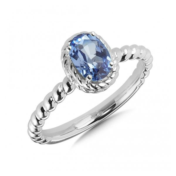 Rhodium Sterling Silver Ring With 7X5mm Created Blue Sapphire.   Size 7 Barnes Jewelers Goldsboro, NC