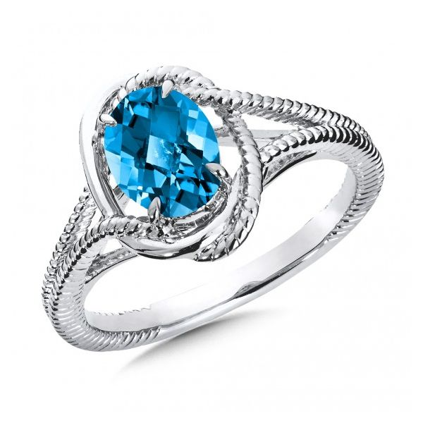 Rhodium Sterling Silver Ring with One 8x6mm Oval Blue Topaz. Size 7 Barnes Jewelers Goldsboro, NC