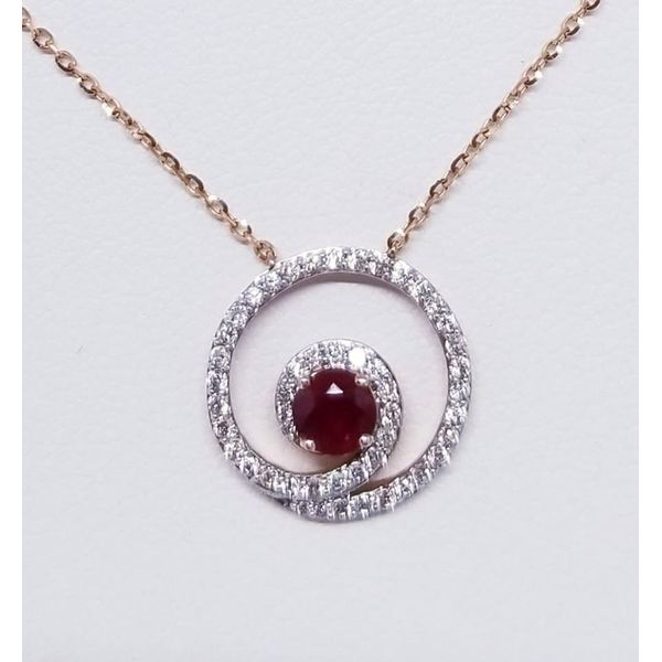 14 Karat Rosé Pendant with One Round Ruby  0.32ct in a 13mm Round Diamond Swirl 0.25tw.  14KR Cable  Chain-  Length Adjustable  Barnes Jewelers Goldsboro, NC