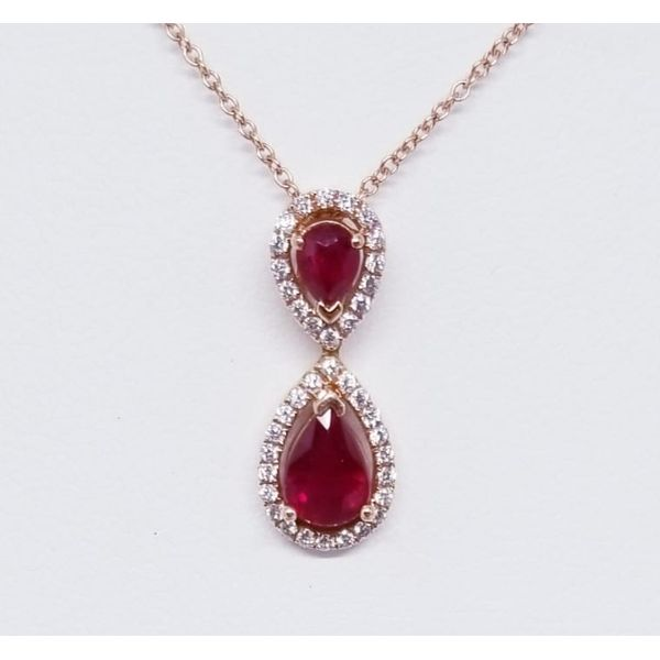 14K Rosé  Ruby & Diamond Pendant with 2 Pear Rubies 1.18 ctw and  Round Diamonds 0.22 tw.   14K Rosé Lite Rope Chain 16