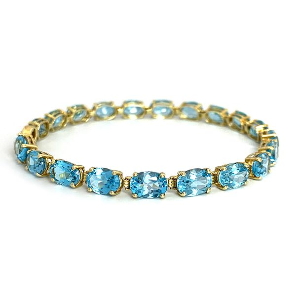 Oval Blue Topaz Yellow Gold Bracelet Coughlin Jewelers St. Clair, MI
