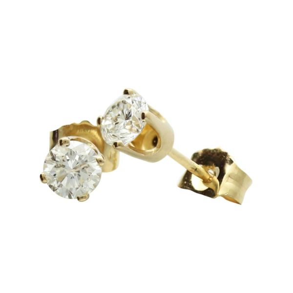 Solitaire diamond earrings in yellow gold. Holliday Jewelry Klamath Falls, OR