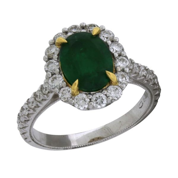 Halo design emerald ring. Holliday Jewelry Klamath Falls, OR