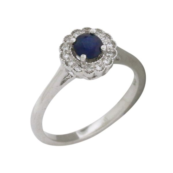 Elegant sapphire and diamond halo style ring. Holliday Jewelry Klamath Falls, OR
