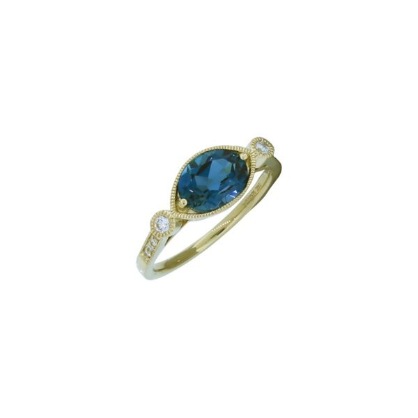 Unique blue topaz and diamond ring. Holliday Jewelry Klamath Falls, OR