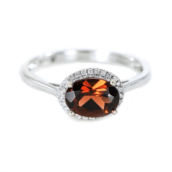 White Gold Ring with Oval Garnet Surrounded by a Halo of Diamonds J. Schrecker Jewelry Hopkinsville, KY
