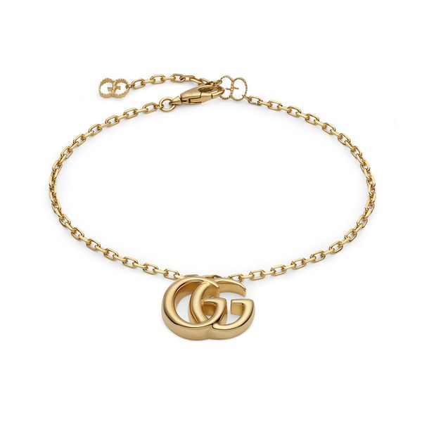 Gucci Running G Bracelet in 18kt Yellow Gold with Double GG Pendant La Mine d'Or Moncton, NB
