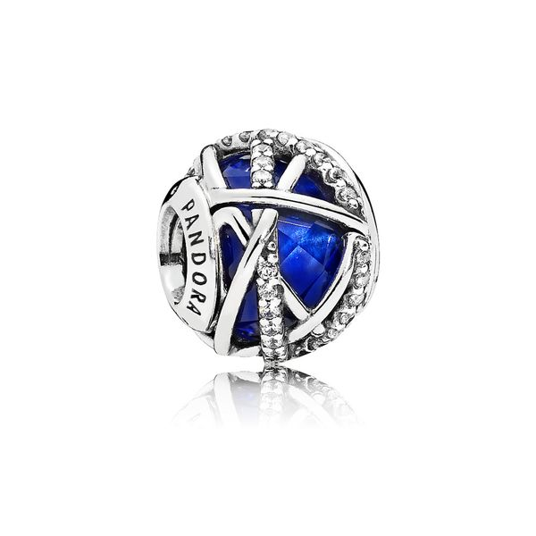 Pandora sterling silver with encased faceted royal blue crystal and clear CZ charm Sanders Diamond Jewelers Pasadena, MD
