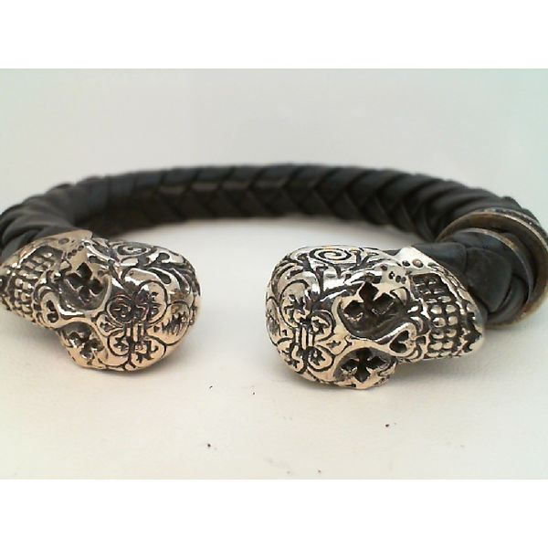 STERLING SILVER SMALL LEATHER CUFF W/ SMALL DAY OF THE DEAD SKULLS BRACELET Sanders Diamond Jewelers Pasadena, MD