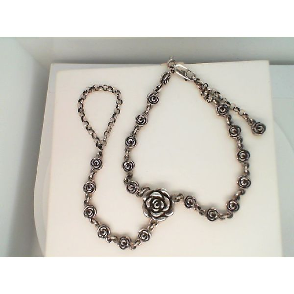 STERLING SILVER HAND CHAIN WITH ROSE MOTIF BRACELET Sanders Diamond Jewelers Pasadena, MD