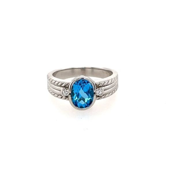 14K White Gold 8X6 mm Oval Blue Topaz Set In A Bezel And 0.06 Twt Diamond 63/4 Swede's Jewelers East Windsor, CT