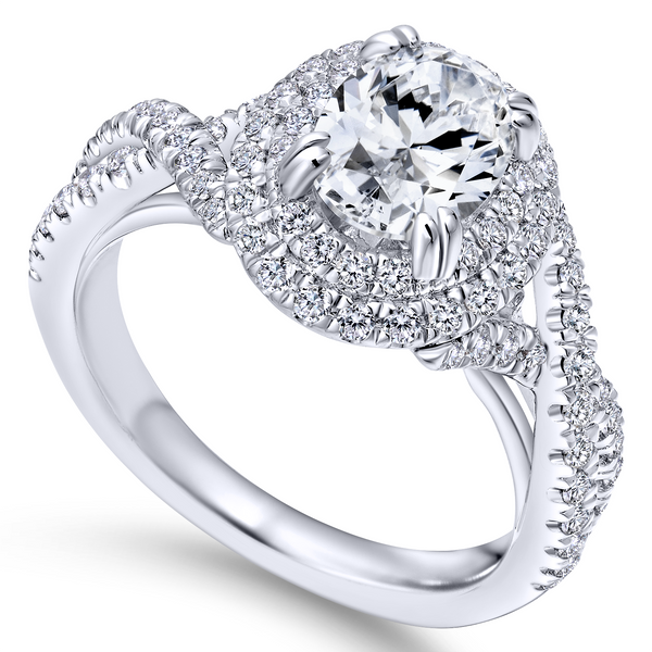 Modern engagement ring featuring two pave diamond halos looped around the oval cut center stone, plus a band of criss crossing d The Ring Austin Round Rock, TX