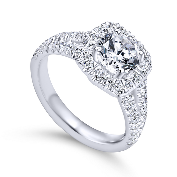Diamond rows split toward the lavish halo in this white gold engagement ring The Ring Austin Round Rock, TX