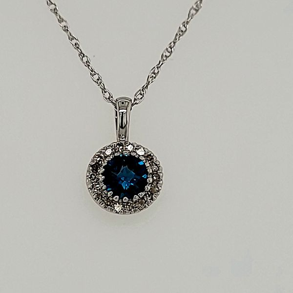 BLUE TOPAZ PENDANT | 14 KARAT WHITE GOLD | BLUE TOPAZ AND DIAMOND Van Scoy Jewelers Wyomissing, PA
