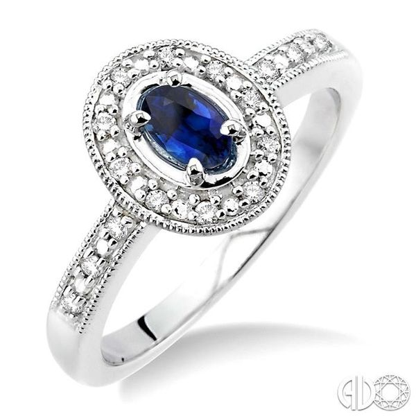 5x3mm Oval Cut Sapphire and 1/10 Ctw Single Cut Diamond Ring in 10K White Gold. Grogan Jewelers Florence, AL