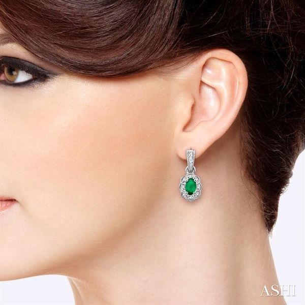5x3mm Oval Cut Emerald and 1/10 Ctw Single Cut Diamond Earrings in 10K White Gold Image 4 Grogan Jewelers Florence, AL