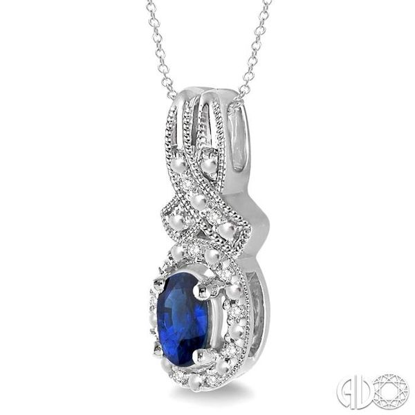 5x3 mm Oval Cut Sapphire and 1/50 Ctw Single Cut Diamond Pendant in Sterling Silver with Chain Image 2 Grogan Jewelers Florence, AL