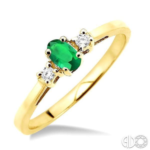 5x3mm Oval Cut Emerald and 1/20 Ctw Round Cut Diamond Ring in 10K Yellow Gold Robert Irwin Jewelers Memphis, TN