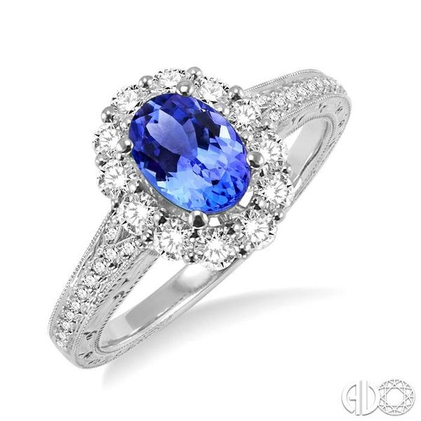 7x5mm Oval Cut Tanzanite and 1/2 Ctw Round Cut Diamond Ring in 14K White Gold Robert Irwin Jewelers Memphis, TN