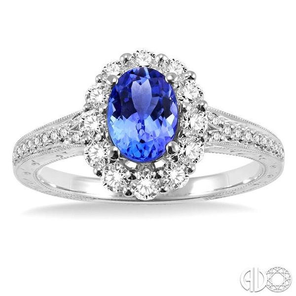 7x5mm Oval Cut Tanzanite and 1/2 Ctw Round Cut Diamond Ring in 14K White Gold Image 2 Robert Irwin Jewelers Memphis, TN