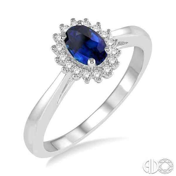 6X4MM Oval Cut Sapphire Center and 1/8 Ctw Round Cut Diamond Halo Precious Stone Ring in 10K White Gold Robert Irwin Jewelers Memphis, TN