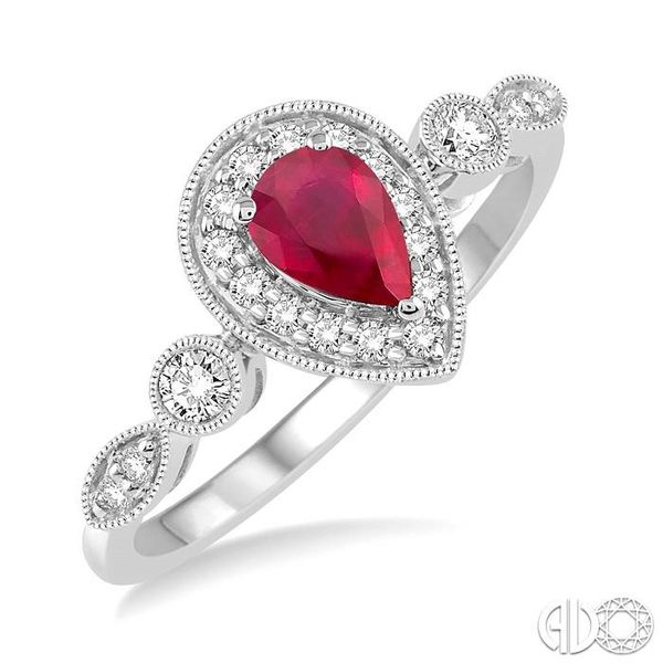 6X4MM Pear shape Ruby Center and 1/4 Ctw Round Cut Diamond Ring in 14K White Gold Robert Irwin Jewelers Memphis, TN