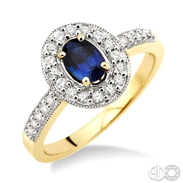6x4mm Oval Cut Sapphire and 1/4 Ctw Round Cut Diamond Ring in 14K Yellow Gold Robert Irwin Jewelers Memphis, TN