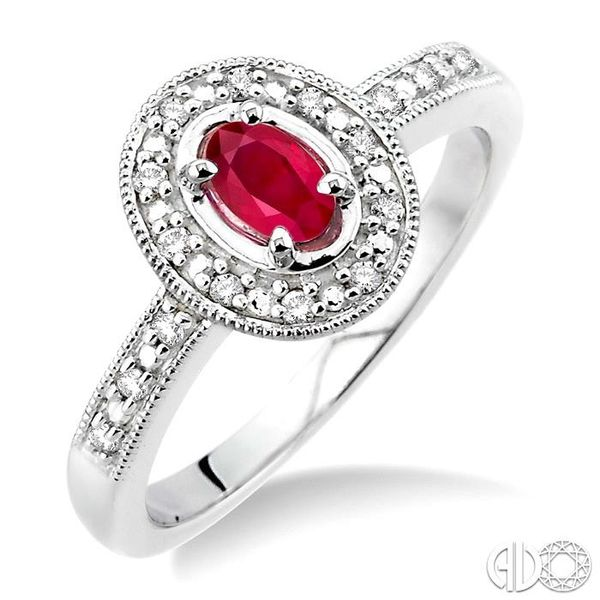 5x3mm Oval Cut Ruby and 1/10 Ctw Single Cut Diamond Ring in 10K White Gold. Robert Irwin Jewelers Memphis, TN