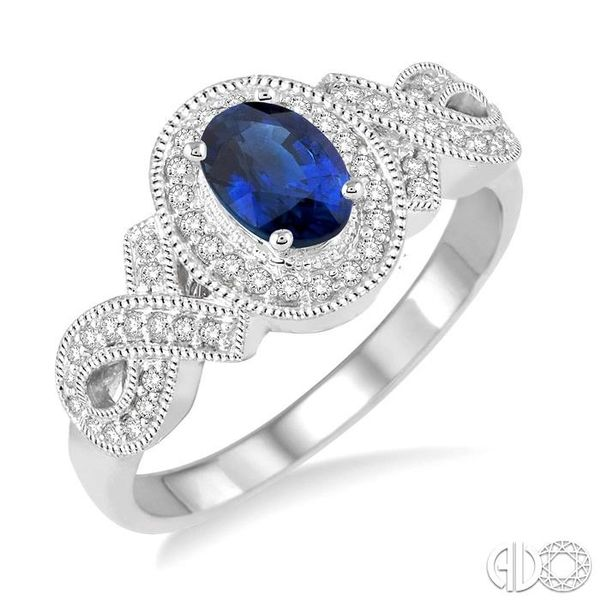 6x4 MM Oval Cut Sapphire and 1/4 Ctw Round Cut Diamond Ring in 10K White Gold Robert Irwin Jewelers Memphis, TN