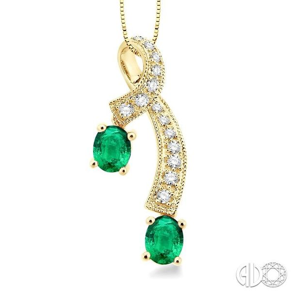 5x4MM Oval Cut Emerald and 1/6 Ctw Round Cut Diamond Pendant in 14K Yellow Gold with Chain Robert Irwin Jewelers Memphis, TN