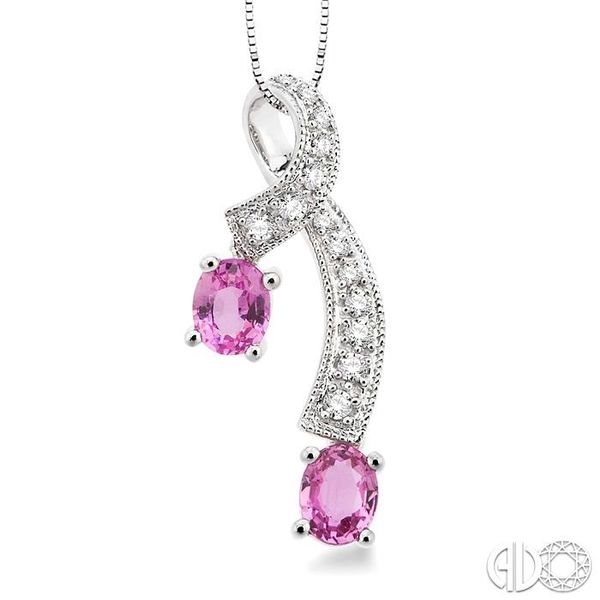 5x4MM Oval Cut Pink Sapphire and 1/6 Ctw Round Cut Diamond Pendant in 14K White Gold with Chain Robert Irwin Jewelers Memphis, TN
