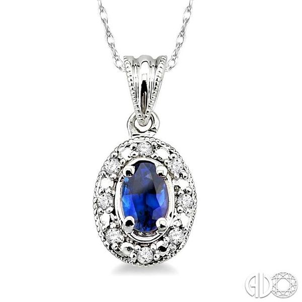 5x3mm Oval Shape Sapphire and 1/20 Ctw Single Cut Diamond Pendant in 10K White Gold with Chain. Robert Irwin Jewelers Memphis, TN
