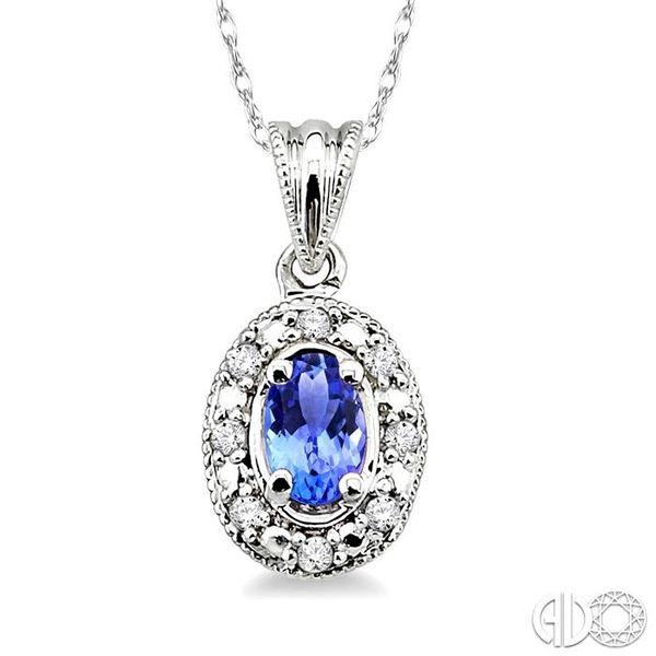 5x3mm Oval Shape Tanzanite and 1/20 Ctw Single Cut Diamond Pendant in 10K White Gold with Chain. Robert Irwin Jewelers Memphis, TN