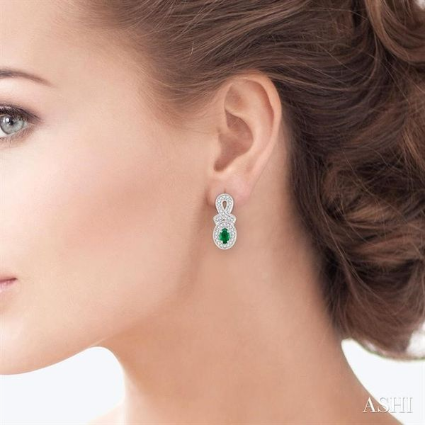5x3 MM Oval Cut Emerald and 1/3 Ctw Round Cut Diamond Earrings in 14K White Gold Image 4 Robert Irwin Jewelers Memphis, TN