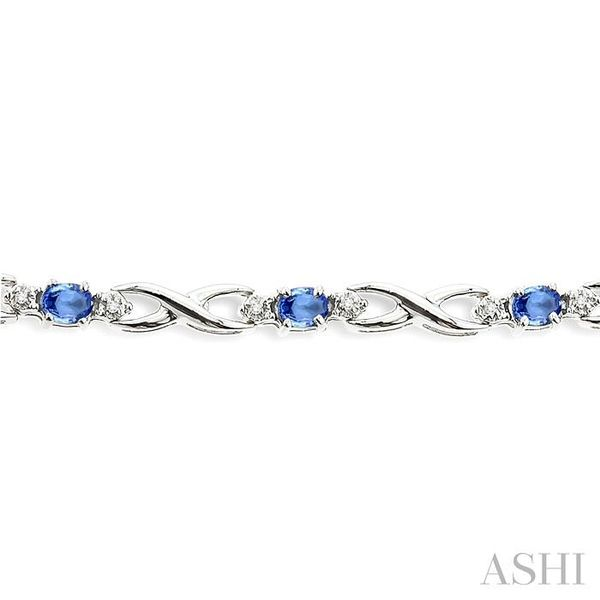 4x3mm Oval Cut Tanzanite and 1/10 Ctw Single Cut Diamond Tennis Bracelet in 10K White Gold Image 3 Seita Jewelers Tarentum, PA