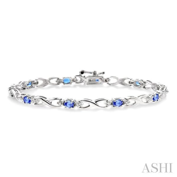 4x3mm Oval Cut Tanzanite and 1/10 Ctw Single Cut Diamond Tennis Bracelet in 10K White Gold Seita Jewelers Tarentum, PA