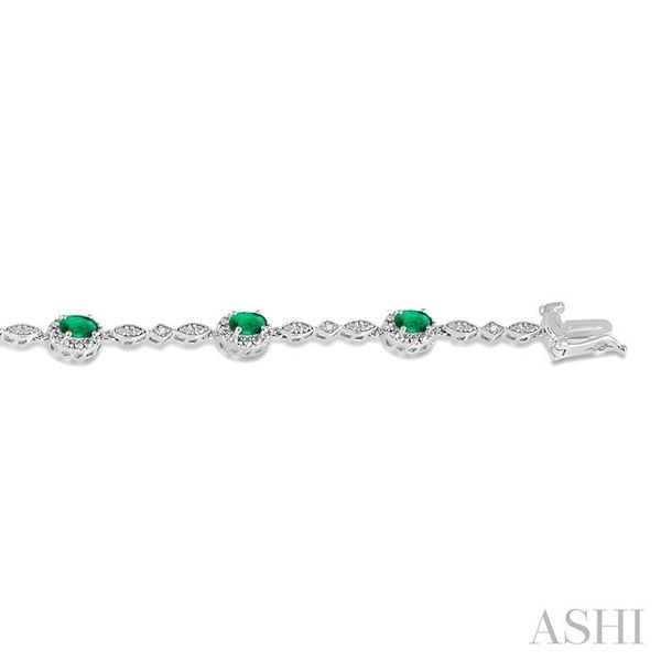 5x3MM Oval Cut Emerald and 1/20 Ctw Single Cut Diamond Tennis Bracelet in 10K White Gold Image 3 Seita Jewelers Tarentum, PA