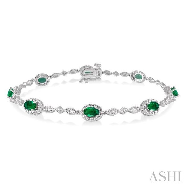 5x3MM Oval Cut Emerald and 1/20 Ctw Single Cut Diamond Tennis Bracelet in 10K White Gold Seita Jewelers Tarentum, PA