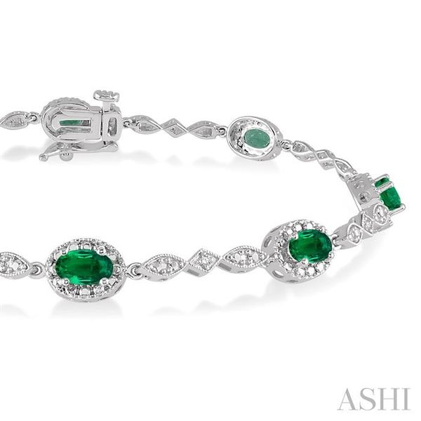 5x3MM Oval Cut Emerald and 1/20 Ctw Single Cut Diamond Tennis Bracelet in 10K White Gold Image 2 Seita Jewelers Tarentum, PA