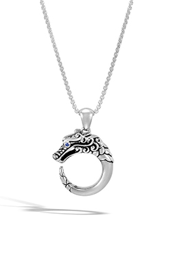 Dragon Shaped Charm on John Hardy Necklace Against White Background.