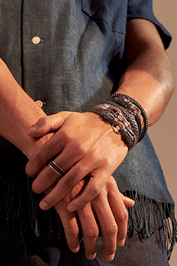 Model with John Hardy bracelets and rings.