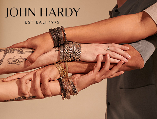 John Hardy bracelets on the outstretched arms of four men.