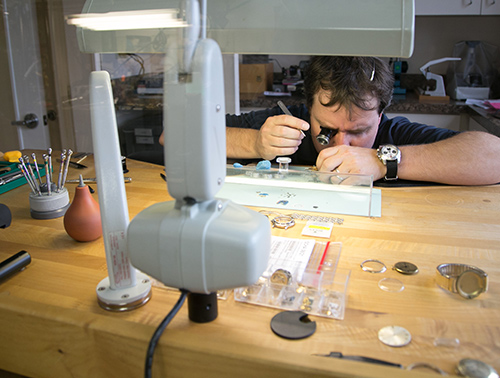 Jeweler Working on Watches at Table