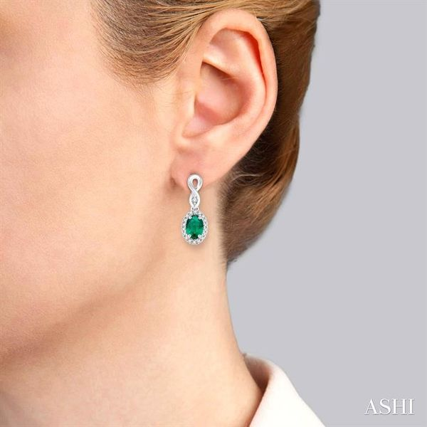 5x3 MM Oval Cut Emerald and 1/6 Ctw Round Cut Diamond Earrings in 10K White Gold Image 4 Trinity Diamonds Inc. Tucson, AZ
